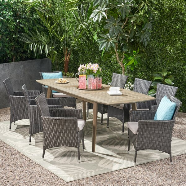 Dafne Outdoor Expandable 9 Piece Dining Set with Cushions by Ivy Bronx