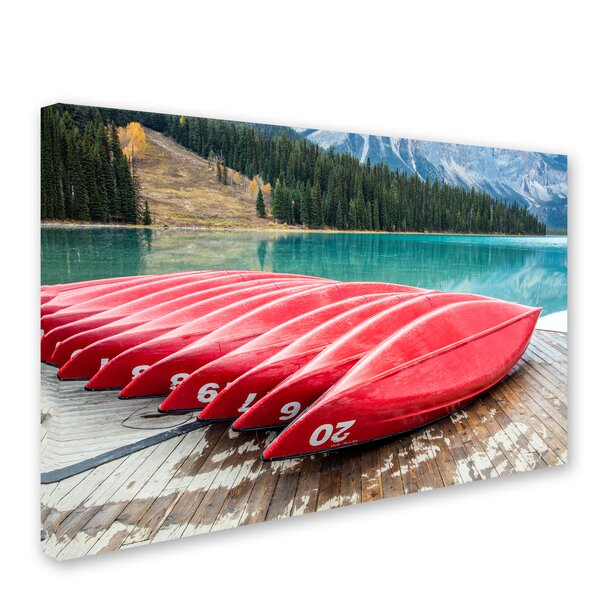 Red Canoes of Emerald Lake by Pierre Leclerc Photographic Print on Wrapped Canvas by Trademark Fine Art