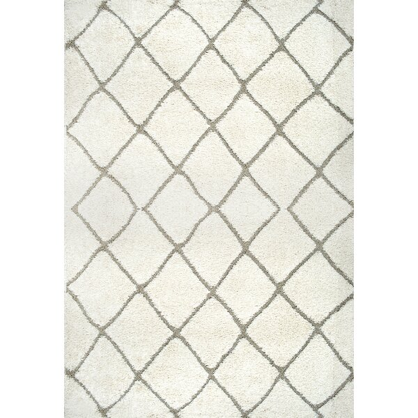 Potter Cream Area Rug by Wrought Studio