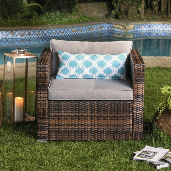 Eitzen Outdoor Furniture All-Weather Mottlewood Brown Wicker Single Chair W Warm Gray Thick Cushions, Teal Pattern Pillow by Bay Isle Home Bay Isle Home