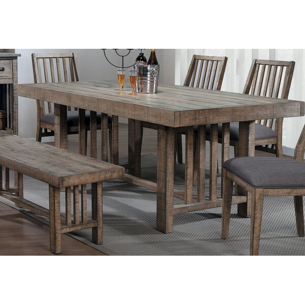 Huang Solid Wood Dining Table by Union Rustic