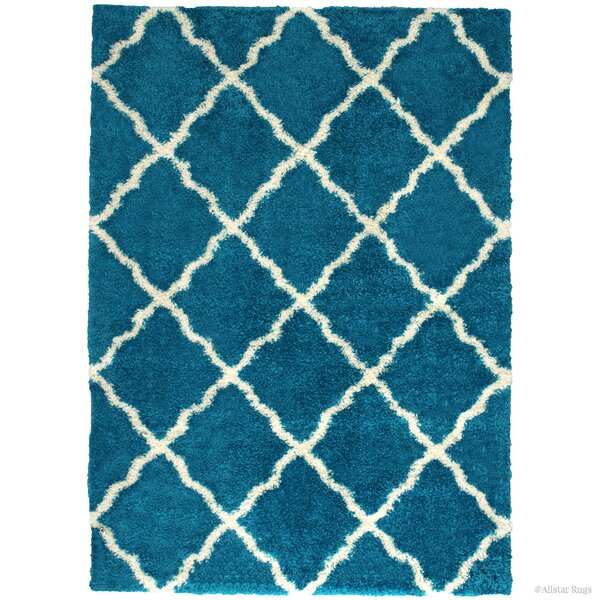 Abbey Turquoise Area Rug by Harriet Bee
