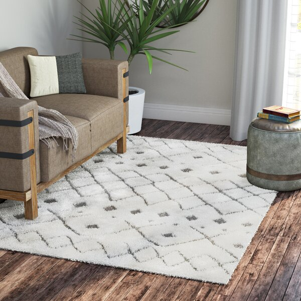 Olga Ivory Area Rug by Gracie Oaks