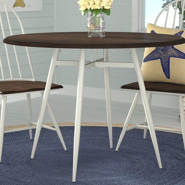 Rio Pinar Solid Wood Round Dining Table by Beachcrest Home