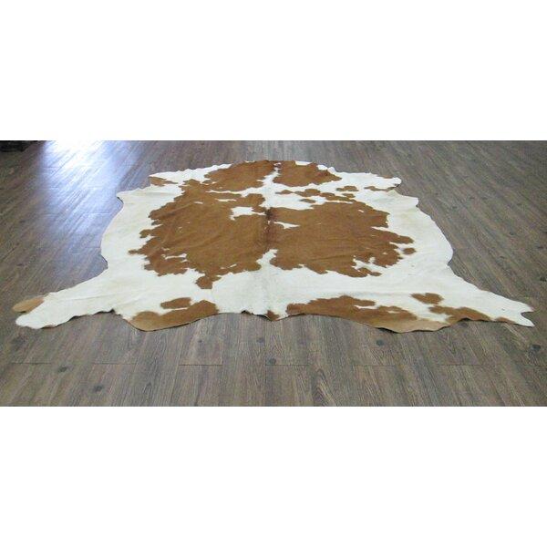 Wilbraham Hand-Woven Cowhide Brown/White Area Rug by Loon Peak