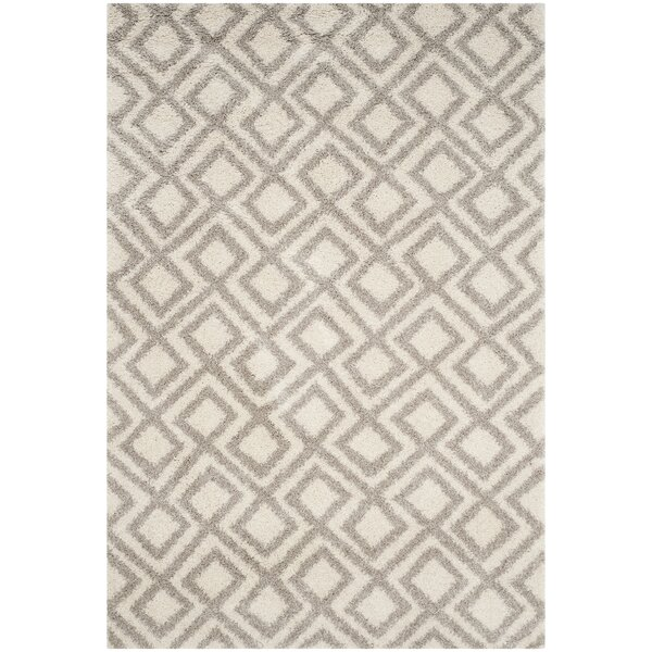 Amicus Ivory/Beige Area Rug by Wrought Studio
