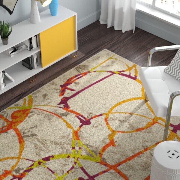 Kolb Morden Circles Orange Area Rug by Zipcode Design