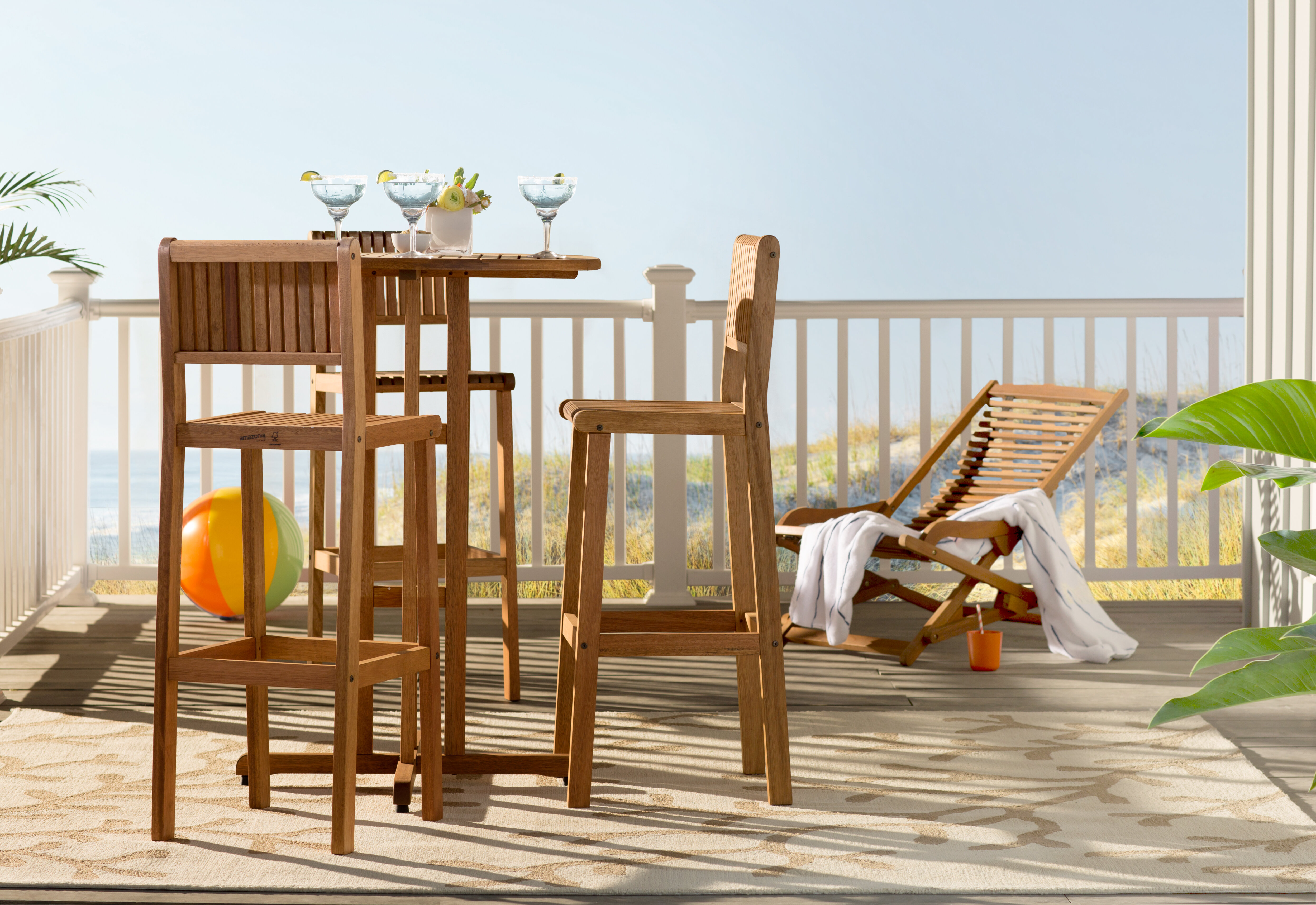 tall outdoor table setting on a deck
