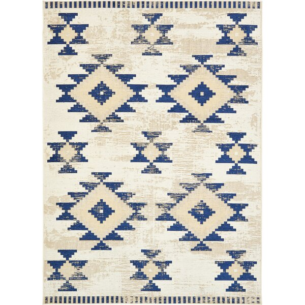 Bhakta Ivory/Navy Blue Area Rug by World Menagerie