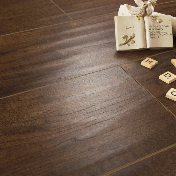 Legno 7 x 48 x 8mm Oak Laminate Flooring in Dark Brown by Patina Design