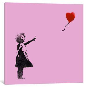 Girl with Balloon by Banksy Graphic Art on Wrapped Canvas in Pink by iCanvas