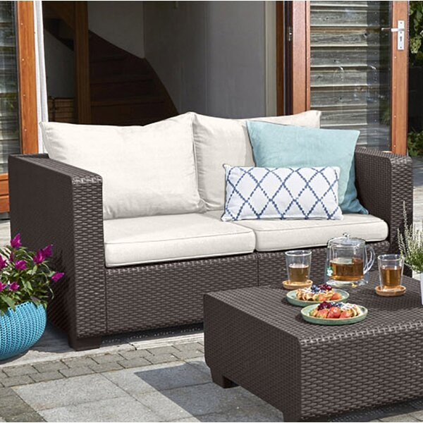 Halloran Loveseat with Sunbrella Cushions by Ivy Bronx