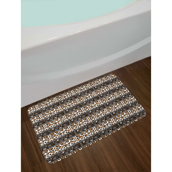 Traditional Borders Cheetah Skin with Abstract Spirals and Circles Bath Rug by East Urban Home