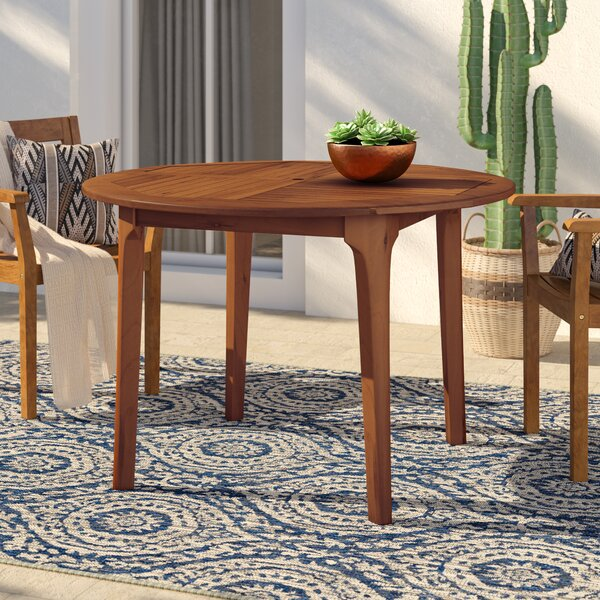 Bridgette Solid Wood Dining Table by Mistana