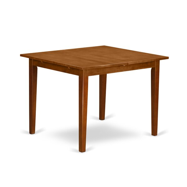 Lorelai Solid Wood Dining Table by Alcott Hill