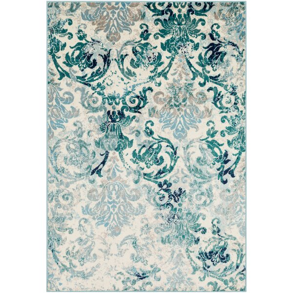 Ramsay Distressed Floral Teal/Light Blue Area Rug by Bungalow Rose