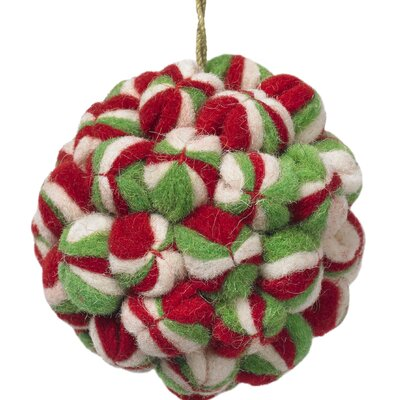Big Pom Pom ornament made of hand felted 100% wool balls.Arcadia Home felt designs are hand-felted, hand appliqued, and lovingly created from 100% sustainable wool by artisans working in India. The facility where these pieces are produced is an award-winning model of sustainability, which runs on solar electricity, collects rainwater, and recycles water on-site. By collaborating with this artisan group, Arcadia Home is helping to preserve the tradition of felt making in the area, promote eco-friendly business, and provide fair and safe employment for hundreds of artisan felt-makers, sheepherders, and seamstresses. Each handmade Arcadia Home design is as unique as the artisan who created it. Arcadia Home