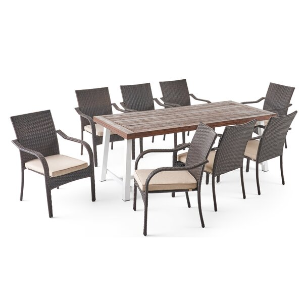 Reiner Outdoor 9 Piece Dining Set with Cushions by Highland Dunes