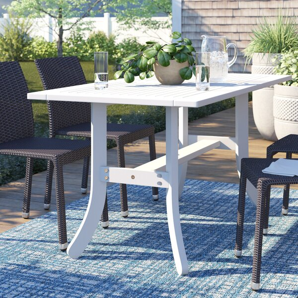 Andromeda Wooden Dining Table by Beachcrest Home