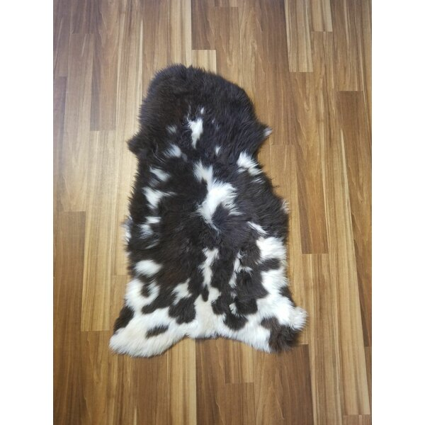 Bustamante Spotted Sheepskin/Wool Black Area Rug by Union Rustic