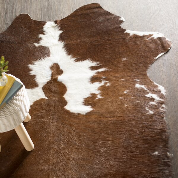 Zenith Handwoven Cowhide Black/White Area Rug by Loon Peak
