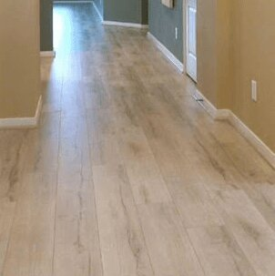 8 x 48 x 12mm Laminate Flooring in Foggy Gray by Yulf Design & Flooring