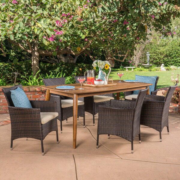 Pelton Outdoor 7 Piece Wicker Dining Set with Cushions by Ivy Bronx