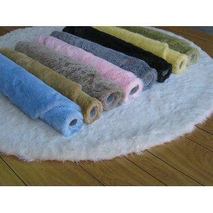 Compare & Buy Eros Hand-TuftedFaux Fur Black Area Rug By IXI