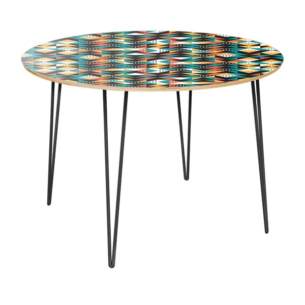 Regil Dining Table by World Menagerie