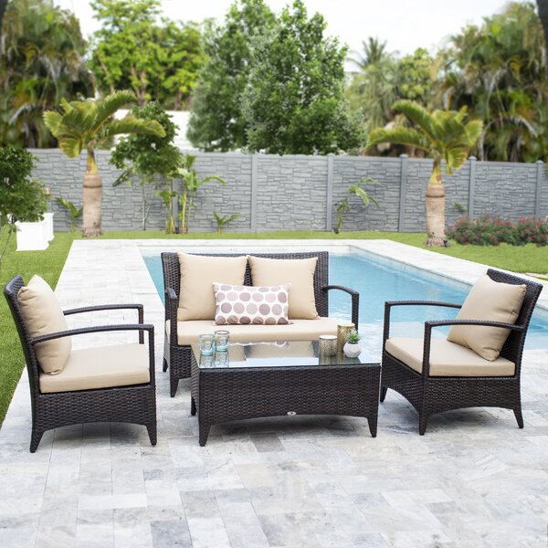 Dicarlo Commercial Grade 4 Piece Rattan Complete Patio Set with Cushions by Darby Home Co