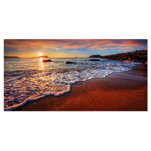 'Stunning Ocean Beach at Sunset' Photographic Print on Wrapped Canvas by Design Art