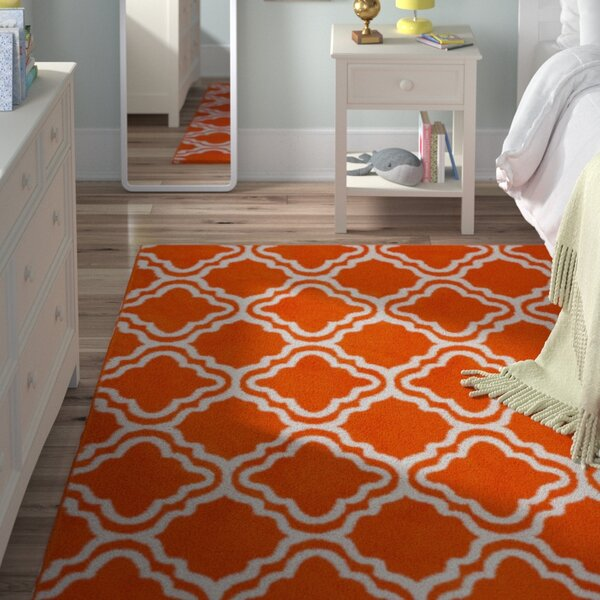Kroeker Calipso Orange Area Rug by Viv + Rae