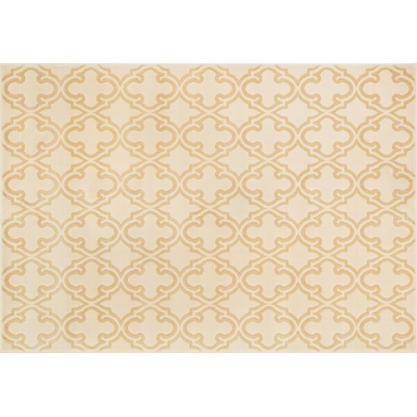 Dann Ivory/Beige Area Rug by Wrought Studio