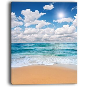 Peaceful Seashore Under White Clouds Modern Beach Photographic Print on Wrapped Canvas by Design Art
