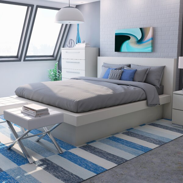 Ben Platform Bed with Rail Seating by Wade Logan