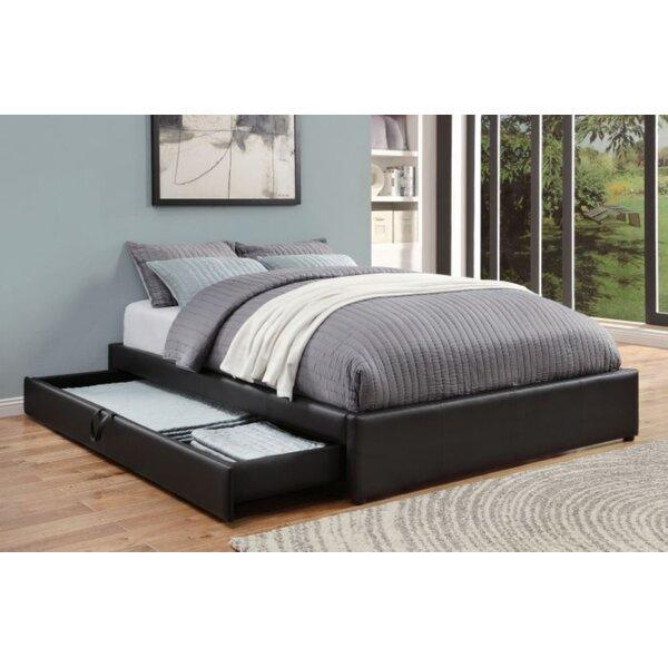 Showman Upholstered Storage Platform Bed by Ebern Designs