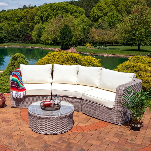 Bronson 4 Piece Rattan Sectional Set with Cushions by Rosecliff Heights