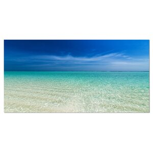 Turquoise Ocean Under Blue Sky Photographic Print on Wrapped Canvas by Design Art