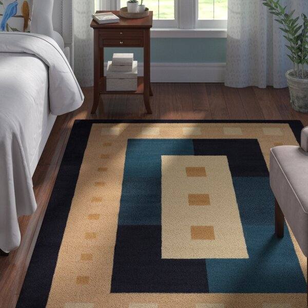 Finnegan Times Square Navy Area Rug by Andover Mills
