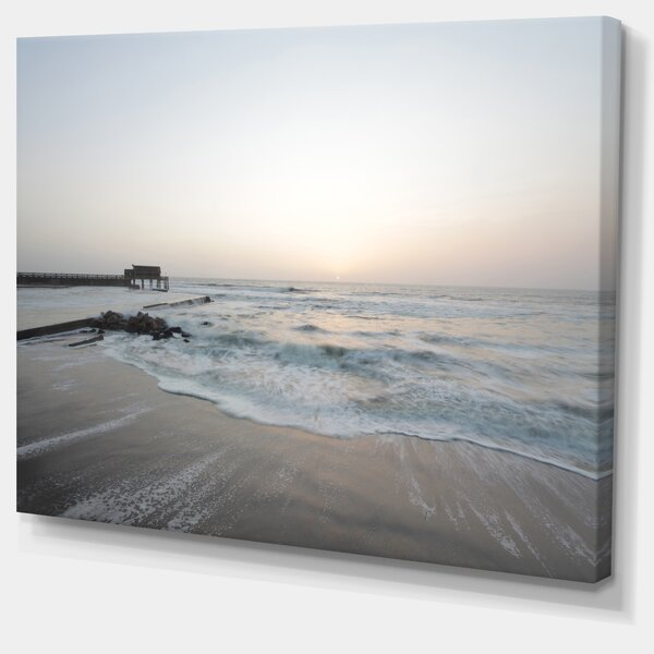 Serene Blue Beach with White Sun Modern Beach Photographic Print on Wrapped Canvas by Design Art