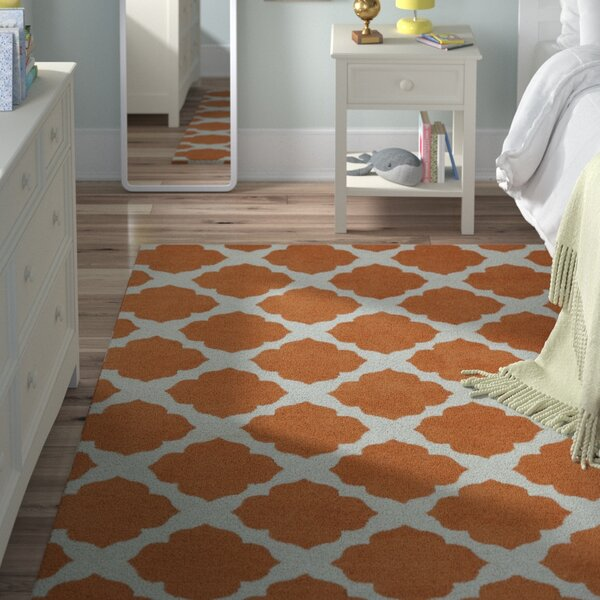 Marie Orange Area Rug by Viv + Rae