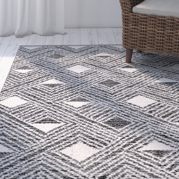 Dominica Hand-Woven Black/Ivory Area Rug by Highland Dunes