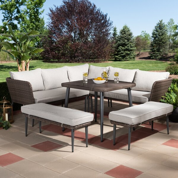 Remmington 4 Piece Rattan Sectional Seating Group with Cushions by Corrigan Studio