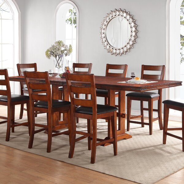 Magellan Solid Wood Dining Table by Loon Peak