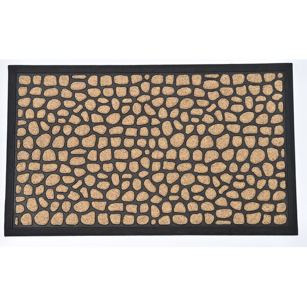 Sheltered Roundstone Polyester Doormat by Evideco