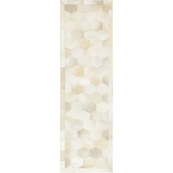 Deford Hand-Woven Cowhide Ivory Indoor Area Rug by Isabelline