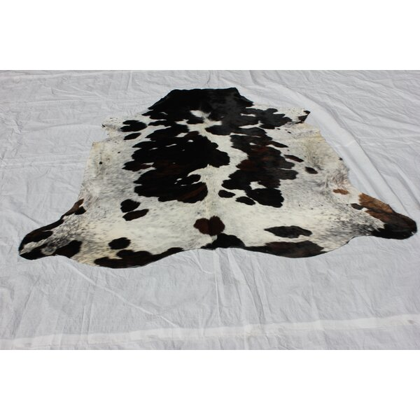 Underwood Hand-Woven Cowhide Black/Ivory Area Rug by Loon Peak