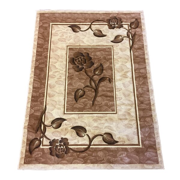 Hand-Carved Cream Area Rug by Brady Home