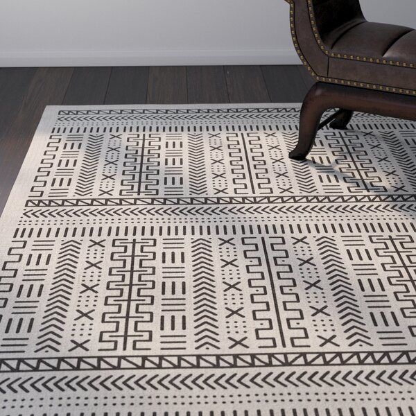 Nemeara Ivory Area Rug by World Menagerie