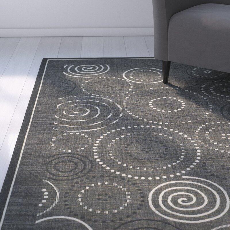 Ebern Designs Mullen Black Sand Circle Outdoor Rug